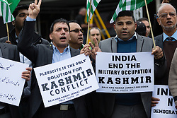 """© Licensed to London News Pictures. 26/10/2014. London, UK. Protesters take part in the """"Kashmir Million March"""" rally in central London on 26th October 2014 to raise awareness of the """"forgotten millions"""" they say are suffering under the Indian occupation in the region of Kashmir. Protesters are also asking David Cameron, the British Prime Minister to push India into resolving the Kashmir situation with Pakistan. Photo credit : Vickie Flores/LNP"""