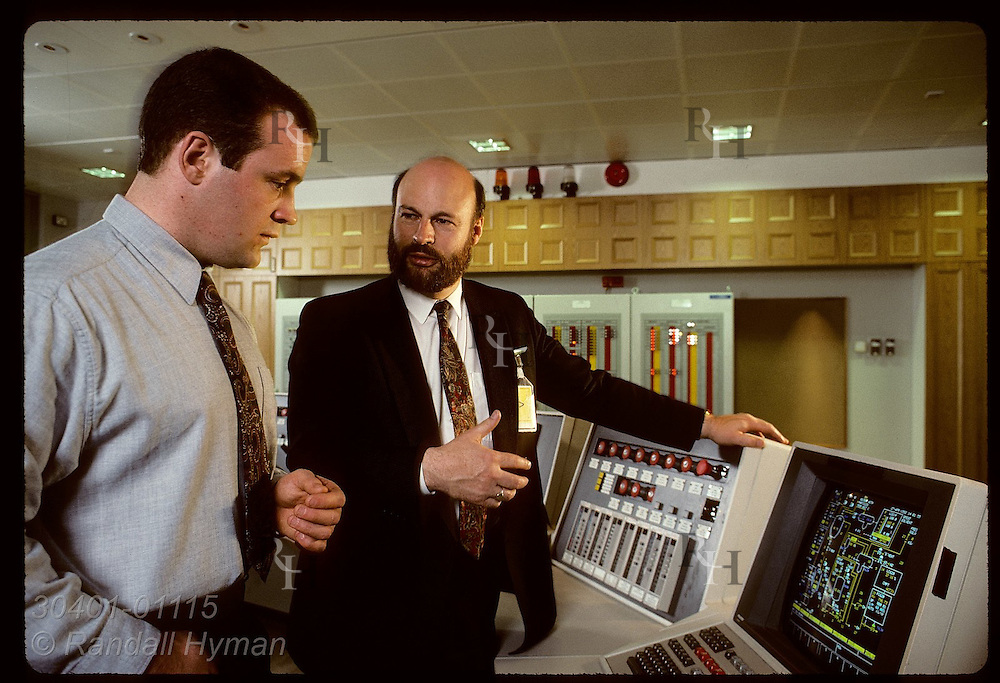 Jim Houston, Provox rep, & client Doug Bell study computer screen at BP Chemicals in Grangemouth. Scotland