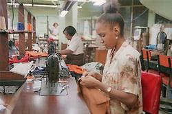 Female machinist using sewing machine in clothes factory in Havana; Cuba,