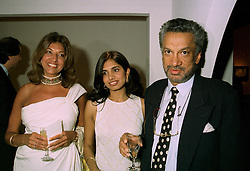 Left to right, MRS VIMLA LALVANI, her daughter MISS DIVIA LALVANI and MR GULU LALVANI a friend of Diana, Princess of Wales, at a reception in London on 12th June 1997.LZH 5
