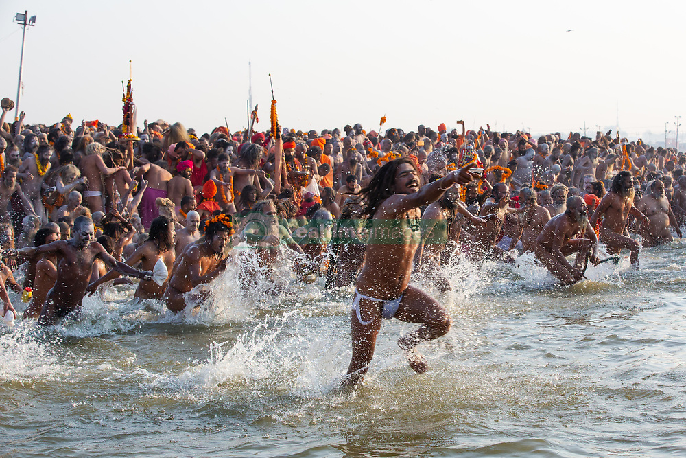 February 10, 2019 - Prayagraj, India - JUNA AKHARA running into the water for their bath. They believe bathing on this special day is a sin cleanser. (Credit Image: © Amazing Aerial via ZUMA Wire)