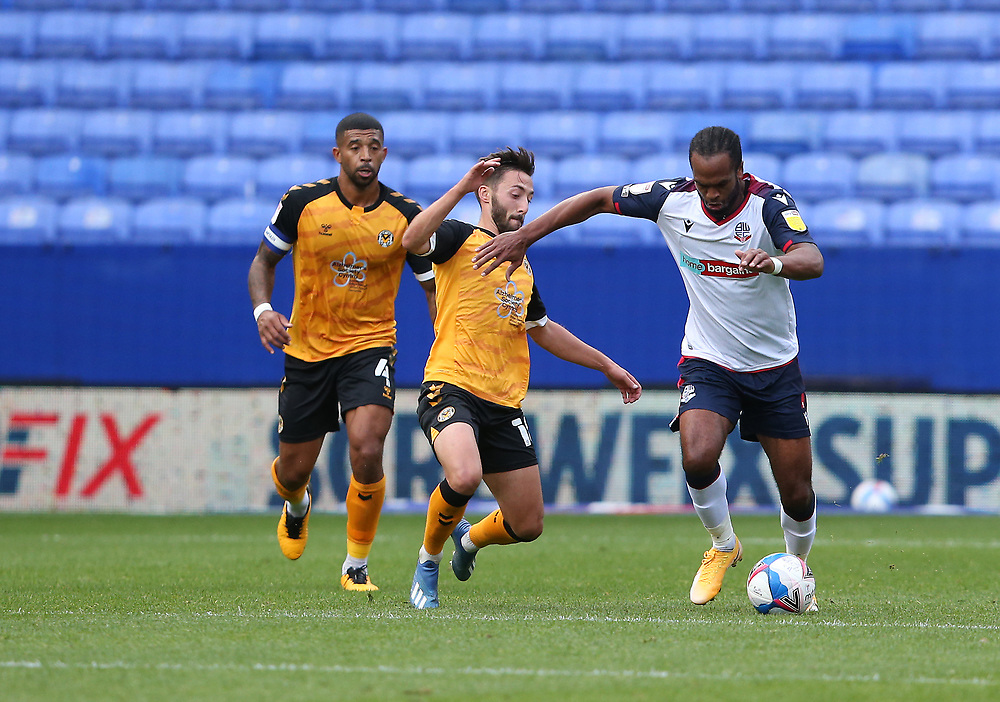 Bolton Wanderers' Nathan Delfouneso avoids the challenge from Newport County's Josh Sheehan<br /> <br /> Photographer Stephen White/CameraSport<br /> <br /> The EFL Sky Bet League Two - Bolton Wanderers v Newport County - Saturday 26th September 2020 - University of Bolton Stadium - Bolton<br /> <br /> World Copyright © 2020 CameraSport. All rights reserved. 43 Linden Ave. Countesthorpe. Leicester. England. LE8 5PG - Tel: +44 (0) 116 277 4147 - admin@camerasport.com - www.camerasport.com