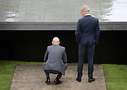 © Licensed to London News Pictures. 31/05/2012. London, UK Architechs Herzog (left) and De Meuron look at the pavilion roof. The press preview today 31st May 2012, of The Serpentine Gallery Pavilion 2012, designed by Herzog & De Meuron and Ai Weiwei. The pavilion is the twelfth commission in the gallery's series of annual pavilions.. Photo credit : Stephen Simpson/LNP