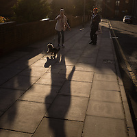 """People walking their dog pass by as I wait to shout """"Way oh"""" as part of Bill Drummond's  The 17th in Liverpool, UK. 27th April, 2013."""
