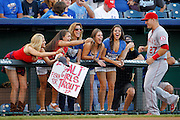 Fans react as Los Angeles Angels center fielder Mike Trout (27) runs over to sign autographs before the start a baseball game against the Kansas City Royals at Kauffman Stadium in Kansas City, Mo., Friday, Aug. 14, 2015. (AP Photo/Colin E. Braley)