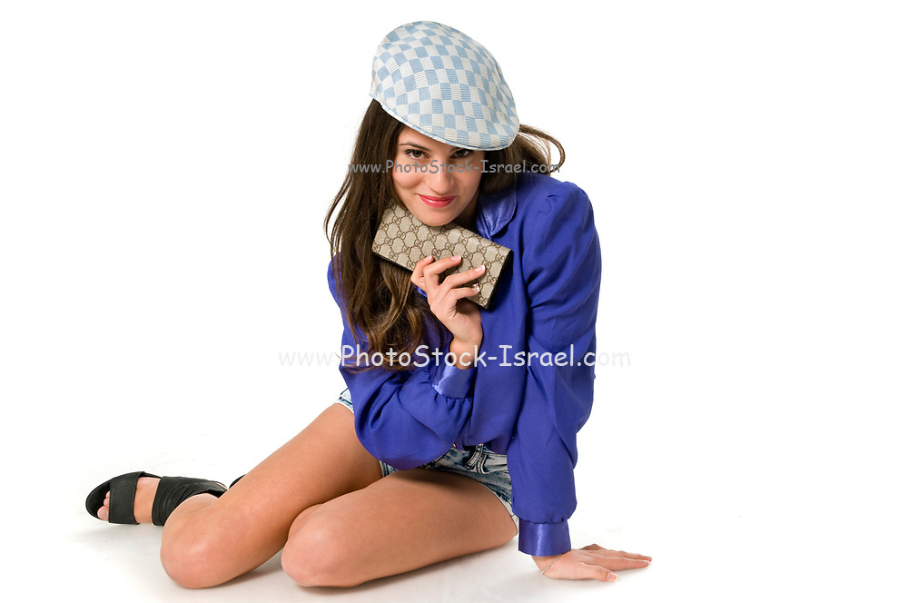 Woman in blue blouse holds her purse under her chin