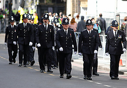 © Licensed to London News Pictures.10/04/2017.London, UK. Police officers in No.1 Dress uniform, line the streets around Southwark Cathedral in London where the funeral of PC Keith Palmer is due to take place this afternoon (Mon). PC Palmer was murdered just inside the gate by Westminster attacker Khalid Masood - an attack in which he also killed four people on Westminster Bridge.Photo credit: Tom Nicholson/LNP