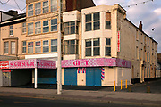 Closed gift shop due to the pandemic on the Golden Mile on 21st April 2021 in Blackpool, Lancashire, United Kingdom. Blackpool is a large town and seaside resort in the county of Lancashire on the north west coast of England. Blackpool was once a booming resort with it's famous promenade which now, despite having a somewhat shabby appearance, still continues to attract millions of visitors each year. During the coronavirus pandemic however, Blackpool has struggled, with empty streets and closed down businesses creating an atmosphere more like a ghost town.
