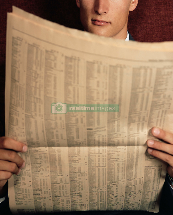 Dec. 14, 2012 - Businessman reading financial newspaper (Credit Image: © Image Source/ZUMAPRESS.com)