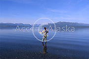 Canada. Yukon. Kluane Lake and fly fisherman,