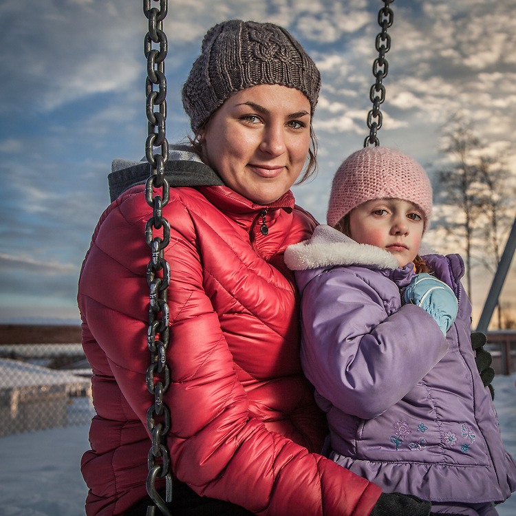 """Au pair, soon to be full time college student, Miriam Becker with Leona (4) and Jack (5) at Chugach Optional Elementary school playground, Anchorage.  """"I arrived from Germany two years ago but Anchorage is now home"""".  miriambecker92@web.de"""