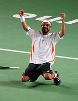 Melbourne  Australian Open  26. 01.06<br />Marcos Baghdatis (CYP) sinks to his knees after beating David Nalbandian |(ARG)  in five sets <br />Photo Roger Parker Fotosports International