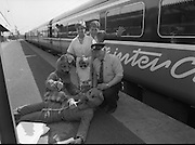 Mosney Holiday Express.   (S4)..1989..27.05.1989..05.27.1989..27th April 1989..The Mosney Holiday Express left Connolly Station,Dublin for its run to Mosney Holiday Camp, Co Meath. The express was sent on its way by Snow White who had left the seven dwarfs at the Olympia Theatre in Dublin. Two bears from the show in the Olympia helped Snow White send the train on its way...Image shows Hazel Ensor and her daughter Rachel from Ballinteer, Dublin with Mosney red coat,Paul Brady and Iarnród Éireann Inspector,Eddie Manning ably assisted by the bears about to board the express to Mosney.
