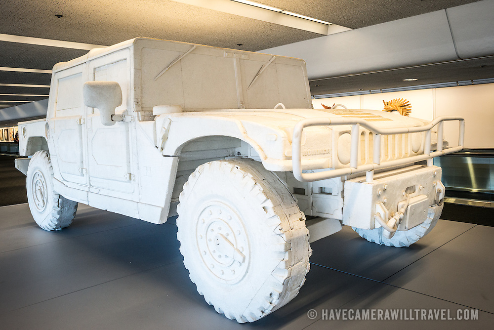 A life-size sculpture of a Hummer H1 made entirely out of styrofoam by San Francisco artist Andrew Junge. The sculpture was constructed from hundreds of pieces of packing material and is on display in San Francisco International Airport's Terminal 3. The items are part of an exhibit titled the Art of Recology: The Artist in Residence Program 1990-2013 that makes use of reclaimed and recycled materials.