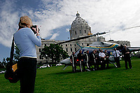 Photojournalist photographs public relations event in front of State Capitol building, Saint Paul, Minnesota