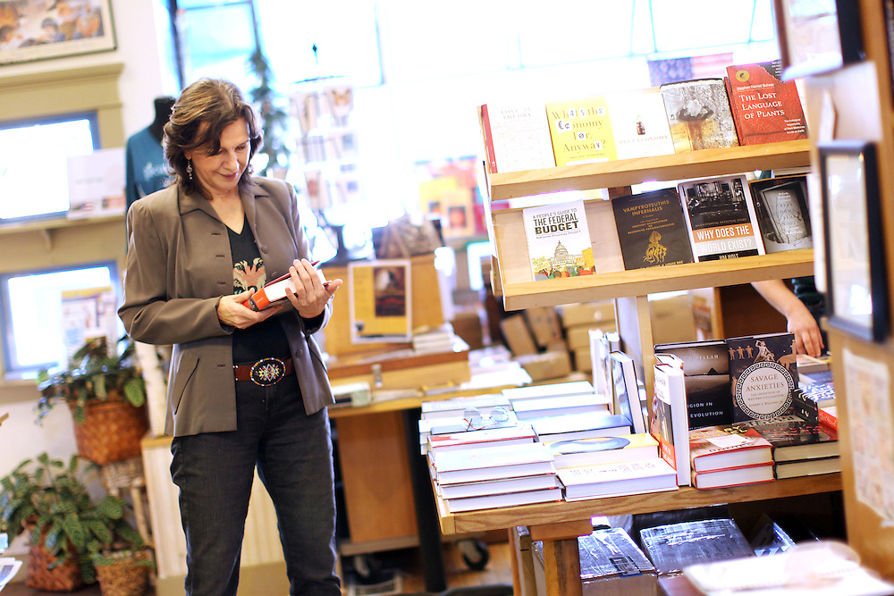 Author Louise Erdrich browses the books on a central display in her bookstore, Birchbark Books and Native Arts, in Minneapolis, MN, September 27, 2012.