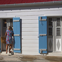 France, Guadeloupe, Les Saintes. Typical resident and building of Bourg de Saintes, Guadeloupe, in the Caribbean.