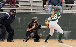 30 March 2013:  Hannah Bowen batting during an NCAA Division III women's softball game between the DePauw Tigers and the Illinois Wesleyan Titans in Bloomington IL