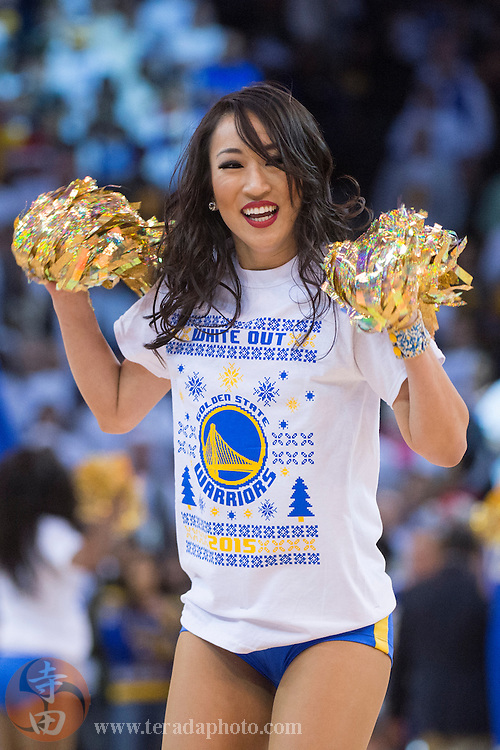 December 25, 2015; Oakland, CA, USA; Golden State Warriors Dance Team dancer Hannie performs during the fourth quarter in a NBA basketball game on Christmas against the Cleveland Cavaliers at Oracle Arena. The Warriors defeated the Cavaliers 89-83.