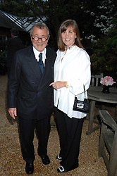 Designer JOSEPH ETTEDGUI and his wife at the annual Cartier Chelsea Flower Show dinner held at the Chelsea Physic Garden on 21st May 2007.<br />