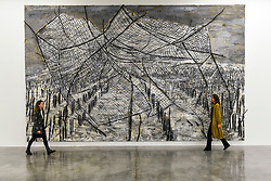 """© Licensed to London News Pictures. 14/11/2019. LONDON, UK. Staff members next to """"The Veneziana Amplitude"""", 2019, by Anselm Kiefer at the preview of a new exhibition called """"Superstrings, Runes, The Norns, Gordian Knot"""" by Anselm Kiefer.  The works include large scale paintings and installations that draw on the scientific concept of string theory and are on display at the White Cube Gallery in Bermondsey 15 November to 26 January 2020.  Photo credit: Stephen Chung/LNP"""