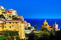 """""""The Dome of Santa Maria Assunta in Positano lights by evening sun""""...<br /> <br /> I never ventured to attempt many photos in the hot daylight sun of Italy; however, as the sun dropped down behind the cliffs of Positano in early evening…the lighting on the picturesque Amalfi village brought out the depth of color and highlighted the plush vegetation.  Around 5:00pm, I positioned the camera at the edge of the opposing cliff to frame this image allowing the colors to derive their true spectrum of light and power.  The focal point of most views of Positano is the church of Santa Maria Assunta.  The colorful dome is made of majolica tiles which are very prominent on the Amalfi Coast, and the church contains a thirteenth-century Byzantine icon of the legendary Black Madonna."""