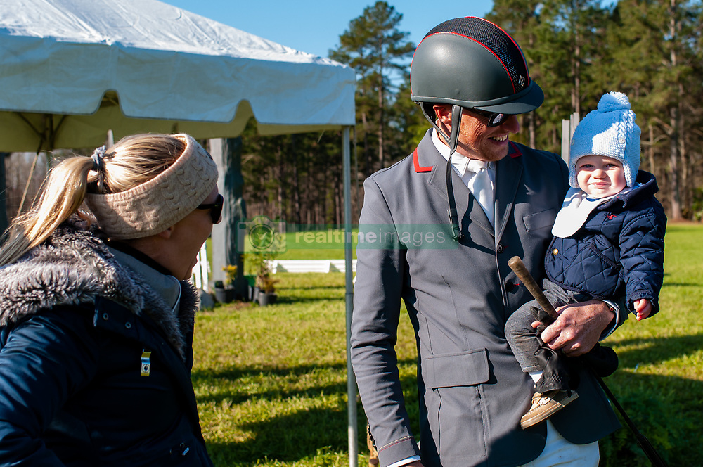 March 22, 2019 - Raeford, North Carolina, US - March 22, 2019 - Raeford, N.C., USA - DOUG PAYNE of the United States relaxes with his son, Hudson, and wife, Jessica, after his first ride in the CCI3-S show jumping division at the sixth annual Cloud 11-Gavilan North LLC Carolina International CCI and Horse Trial, at Carolina Horse Park. The Carolina International CCI and Horse Trial is one of North AmericaÃ•s premier eventing competitions for national and international eventing combinations, hosting International competition at the CCI2*-S through CCI4*-S levels and National levels of Training through Advanced. (Credit Image: © Timothy L. Hale/ZUMA Wire)