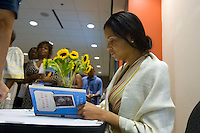 """Victoria Rowell signs copies of her book, """"The Women Who Raised Me,"""" after a showing of Rowell's documentary, """"The Mentor,"""" at the Woodruff Arts Center in Atlanta on Sunday, July 29, 2007."""