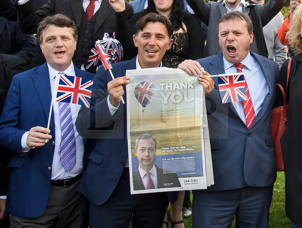 © Licensed to London News Pictures. 24/06/2016. London, UK.  Current UKIP leader GERARD BATTEN, ANDY WIGMORE and UKIP donor ARRON BANKS celebrating in Westminster on the day that the UK voted to leave the EU in a referendum. Photo credit: Ben Cawthra/LNP