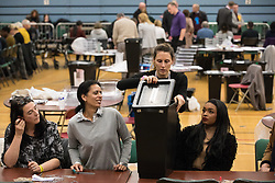 Maidenhead, UK. 12 December, 2019. A Royal Borough of Windsor and Maidenhead count supervisor opens a ballot box for the general election in the Maidenhead constituency.