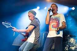 © Licensed to London News Pictures. 16/10/2013. London, UK.   Deep Purple performing live at The Roundhouse. Deep Purple consist of members Ian Paice (drums, percussion),<br /> Roger Glover (bass),Ian Gillan (vocals),Steve Morse (guitar), Don Airey (organ).  In this pic -  Roger Glover (left), Ian Gillan (right).  Photo credit : Richard Isaac/LNP