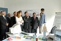 """24 JUN 2003, BERLIN/GERMANY:<br /> Edelgard Bulmahn, SPD, Bundesbildungsministerin, Gerhard Schroeder, SPD, Bundeskanzler, und Reinhard Uppenkamp, Vorstandsvorsitzender Berlin Chemie AG, im Gespraech mit einem Auszubildenden (v.L.n.R.),  waehrend einem Besuch der Berlin-Chemie AG im Rahmen einer Sitzung des Runden Tisches """"Ausbilden jetzt - Erfolg braucht alle"""", Berlin-Chemie AG<br /> IMAGE: 20030624-01-013<br /> KEYWORDS: Gerhard Schröder"""