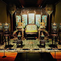 """TREVISO, ITALY - NOVEMBER 12:  A general view of the throne of the Celestial emperor for the very first time outside China at the Casa dei Carraresi on November 12, 2011 in Treviso, Italy.  The exhibition called, """"Manchu, The Last Emperor"""" will stay open until the 13th May 2012.  (Photo by Marco Secchi/Getty Images)"""