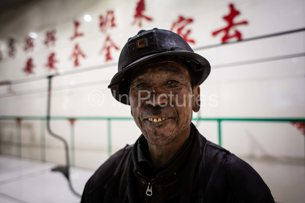 A miner walks out after a shift at a coal mine and processing facility in Liulin, Shanxi province, China, on Thursday, May 19, 2016. Shanxi is facing a challenge shared by a sweeping region across Chinas industrial north: how to shut down cash-burning mines that employ millions of people whose prospects are uncertain in the new economy promised by President Xi Jinping.