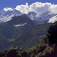 Cordillera Vilcabamba, Andes Mountains, Peru. Ben Wiltsie on outcrop near Cerro Victoria Pass, overlooking Nevado Sacsarayoc.