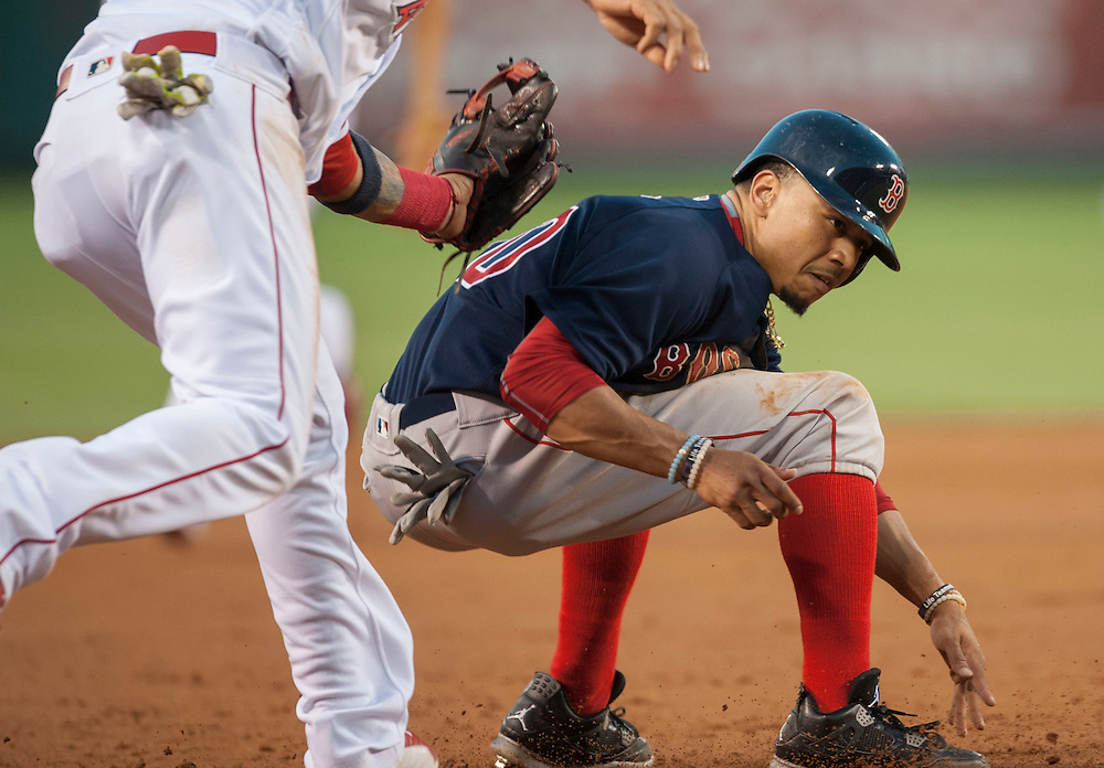Boston's Mookie Betts is tagged out by the Angels' Yunel Escobar after getting caught trying to steal third at Angel Stadium on Friday.<br /> <br /> ///ADDITIONAL INFO:   <br /> <br /> angels.0730.kjs  ---  Photo by KEVIN SULLIVAN / Orange County Register  -- 7/29/16<br /> <br /> The Los Angeles Angels take on the Boston Red Sox at Angel Stadium.