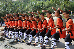 September 29, 2016 - Dengfeng, Dengfeng, China - Dengfeng,CHINA-September 29 2016:?(EDITORIAL?USE?ONLY.?CHINA?OUT) Monks of Shaolin Temple practice martial arts in a square at the foot of the Mount Song in Dengfeng, central China¬°¬Øs Henan Province, September 29th, 2016. Dengfeng is one of the most renowned spiritual centers of China, home to martial arts, various religious institutions and temples, such as the Taoist Zhongyue Temple, the Buddhist Shaolin Temple.During the upcoming National Day holiday, numerous tourists will flock to Dengfeng. (Credit Image: © SIPA Asia via ZUMA Wire)