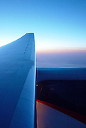 Sunset across the wing of a plane <br /> <br /> Editions:- Open Edition Print / Stock Image