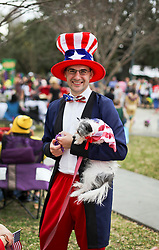31 January 2016. New Orleans, Louisiana.<br /> Mardi Gras Dog Parade. Andy Wilcox and dog 'Smoggy.' The Mystic Krewe of Barkus winds its way around the French Quarter with dogs and their owners dressed up for this year's theme, 'From the Doghouse to the Whitehouse.' <br /> Photo©; Charlie Varley/varleypix.com
