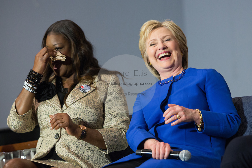 Democratic presidential candidate Hillary Rodham Clinton and Sybrina Fulton, mother of Trayvon Martin share a laugh during the Breaking Down Barriers Forum on gun violence at Central Baptist Church February 23, 2016 in Columbia, South Carolina. The event was attended by mothers who lost their children to gun violence and police incidents.