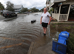 A local resident stands in flood waters surveying the town after Hurricane Irma swept through the area on Monday, September 11, 2017, in St. Marys, GA, USA. Photo by Curtis Compton/Atlanta Journal-Constitution/TNS/ABACAPRESS.COM