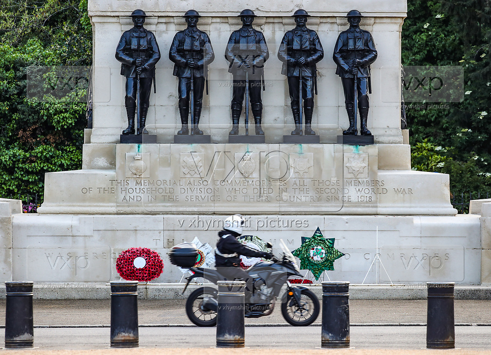 A man drives his motorbike along the way in front of a memorial in London, Friday, May 8, 2020, on the 75th anniversary of the end of World War II in Europe. The 75th anniversary of the end of World War II in Europe should be all about parades, remembrances, and one last great hurrah for veteran soldiers who are mostly in their nineties. Instead, it is a time of coronavirus lockdown and loneliness spent in search of memories both bitter and sweet. (Photo/ Vudi Xhymshiti)