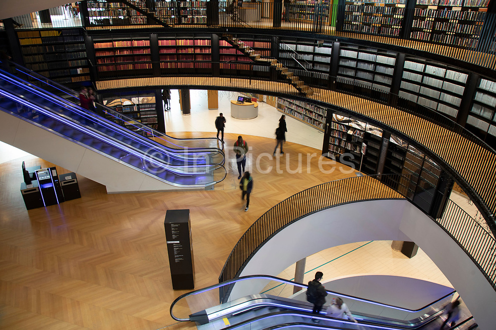 Interior of the Library of Birmingham Birmingham, United Kingdom. The Library of Birmingham is a public library in Birmingham, England. It is situated on the west side of the city centre at Centenary Square, beside the Birmingham Rep to which it connects, and with which it shares some facilities and Baskerville House. Upon opening on 3 September 2013, it replaced Birmingham Central Library. The library is viewed by the Birmingham City Council as a flagship project for the citys redevelopment. It has been described as the largest public library in the United Kingdom, the largest public cultural space in Europe, and the largest regional library in Europe.