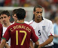 Photo: Chris Ratcliffe.<br /> England v Portugal. Quarter Finals, FIFA World Cup 2006. 01/07/2006.<br /> Rio Ferdinand of England shakes hands with Ronaldo of Portugal.