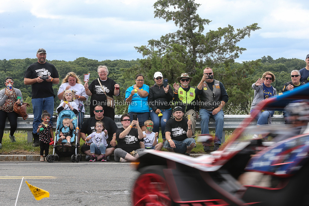 (8/25/19, FRAMINGHAM, MA) Spectators wave to riders  during the New England Ride for Kids hosted by the Pediatric Brain Tumor Foundation at Bose Corporation in Framingham on Sunday. [Daily News and Wicked Local Photo/Dan Holmes]