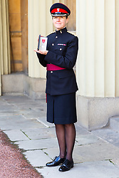 Major Rebecca Pogson-Hughes-Emanuel of the Royal Electrical and Mechanical Engineer poses with her MBE awarded at an investiture by HRH The Prince of Wales at Buckingham Palace in London. London, February 07 2019.
