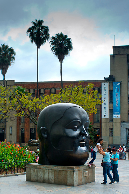 'The Head' is a sculpture in Plaza Botero by the artist Fernando Botero, a Medellin native known for his exaggerated forms.  People in the plaza enjoy climbing on the statues for pictures.