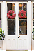 Christmas wreath on the door of a historic building in Charleston, South Carolina.
