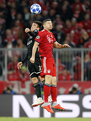 (l-r) Nico Tagliafico of Ajax, Robert Lewandowski of FC Bayern Munchen during the UEFA Champions League group E match between Bayern Munich and Ajax Amsterdam at the Allianz Arena on October 02, 2018 in Munich, Germany