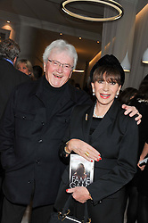 LESLIE BRICUSSE and his wife EVE BRICUSSE at a party to celebrate the publication of Fame Game by Louise Fennell held at Grace, West Halkin Street, London on 12th March 2013.